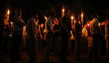 In this photo taken August 11, 2017, multiple white nationalist groups march with torches through the UVA campus in Charlottesville, Virginia.