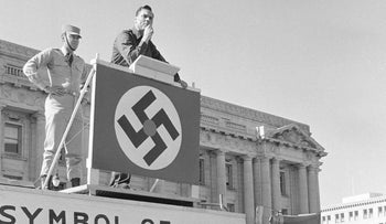 American Nazi leader George Lincoln Rockwell tries to be heard over jeers during a Civic Center rally in San Francisco, Oct. 22, 1966.