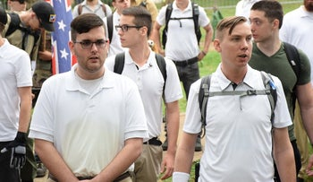 James Alex Fields Jr., left, in a crowd of white nationalists in Charlottesville, Va., on Saturday. Hours later, the police say, he killed a 32-year-old woman and injured 19 other people by driving a car into a line of other cars.