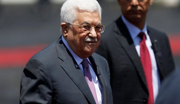 Palestinian President Mahmoud Abbas stands during a reception ceremony for Jordan's King Abdullah II in the West Bank city of Ramallah, August 7, 2017. Picture taken August 7, 2017. REUTERS/Mohamad Torokman