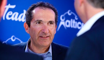 (FILES) This file photo taken on March 21, 2017 shows French telecom and Media group Altice founder Patrick Drahi during a press conference in Paris.