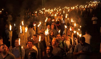 White nationalists carry torches on the grounds of the University of Virginia, on the eve of a planned Unite The Right rally in Charlottesville, Virginia, U.S. August 11, 2017. Picture taken August 11, 2017.