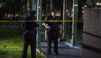 Boston Police guard the crime scene around the New England Holocaust Memorial that was vandalized when a rock was thrown at a glass panel that was part of the memorial on August 14, 2017 in Boston, Massachusetts.