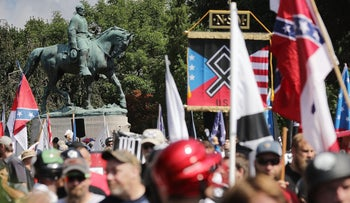 """The statue of General Robert E. Lee behind white nationalists, neo-Nazis and members of the """"alt-right"""" during the """"Unite the Right"""" rally August 12, 2017 in Charlottesville, Virginia."""
