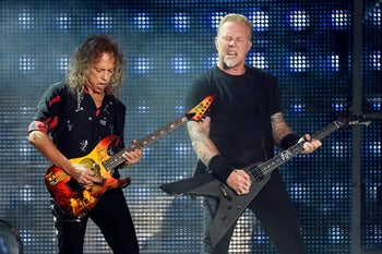 Kirk Hammett, left, and James Hetfield of Metallica perform during the band's concert at The Rose Bowl on Saturday, July 29, 2017, in Pasadena, Calif.