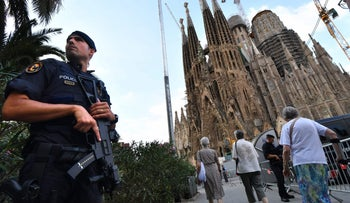A police offier stands by the Sagrada Familia basilica following a deadly terror attack in Barcelona, Spain, August 20, 2017.