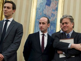 From left, Senior Adviser Jared Kushner, policy adviser Stephen Miller, and chief strategist Steve Bannon watches as President Donald Trump signs an executive order