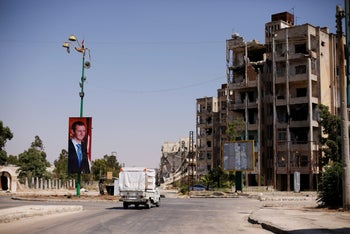 A picture of Syria's President Bashar Assad in Waer district in the central Syrian city of Homs, July 26, 2017.