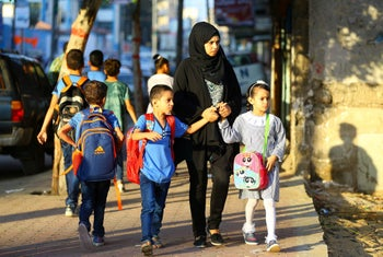 Palestinian children being dropped off at school on the first day of the new academic year, at a UN-run school in the Al-Shatee refugee camp, Gaza City, August 23, 2017.