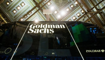 A Goldman Sachs sign is seen above the floor of the New York Stock Exchange shortly after the opening bell in Manhattan, January 24, 2014.