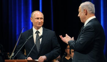 Putin and Netanyahu at a concert, dedicated to the 25th anniversary of the restoration of diplomatic relations between the two countries, at the Bolshoi Theater in Moscow, June 7, 2016.
