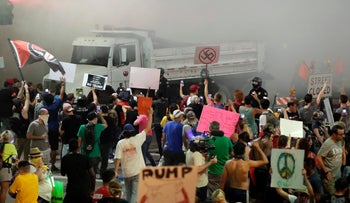 Phoenix police uses tear gas to disperse protesters outside of a Donald Trump rally in Phoenix, Arizona, August 22, 2017.