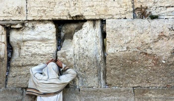 Reform Jewish women from U.S. ordered to lift shirts, skirts before entering Western Wall. File Picture: Tisha B'Av prayer at the Kotel