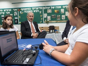 Prime Minister Benjamin Netanyahu visits the Yodfat elementary school in Upper Nazareth on the first day of the 2016-17 school year, Sept. 1, 2016.