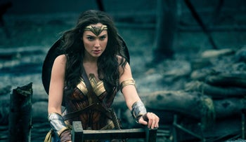 "Israeli actress Gal Gadot, in her character's iconic garb, emerges from a trench in a scene from ""Wonder Woman."""