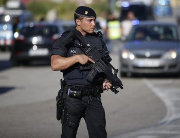 An armed police officer stand guard near Subirats, Spain, Aug. 21, 2017.