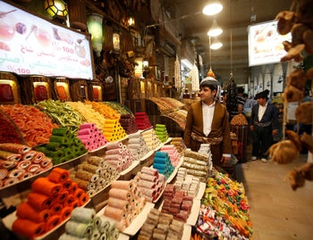 A Kurdish man sells sweets at a market in Arbil, the capital of the autonomous Kurdish region of northern Iraq