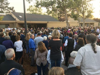 A vigil being in Alameda after after two windows were broken at the island city's Temple Israel synagogue.