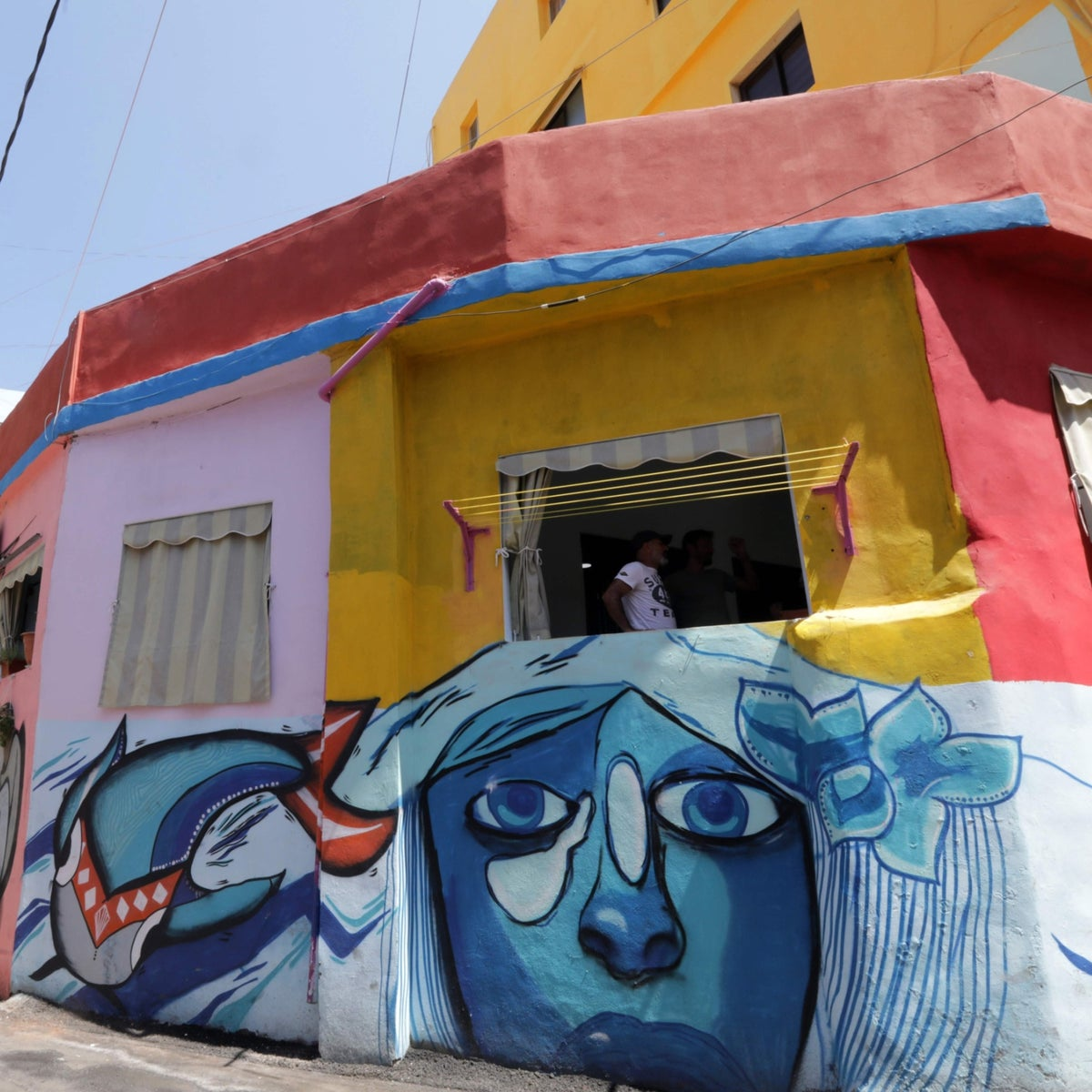 Painted houses in Beirut's southern Ouzai neighborhood as part of Ayad Nasser's project, in August 2017.