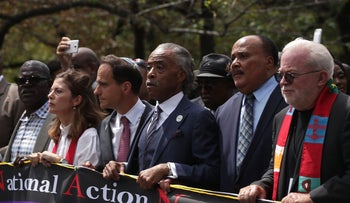 The Rev. Al Sharpton (center), Rabbi Jonah Pesner of Religious Action Center of Reform Judaism (to his left) lead the Ministers March for Justice, in Washington, August 28, 2017.