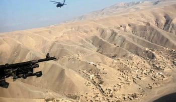 Mining in Afghanistan: An American helicopter flies near a gold mine site in Nor Aaba, Takhar Province. Detractors of plans to exploit the mineral wealth point to the absence of infrastructure and warring clans. November 26, 2010