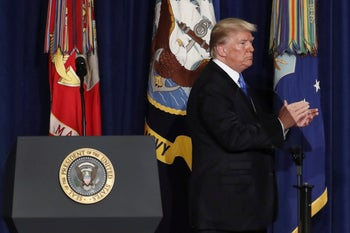 Trump applauds as he walks off the dais after speaking at Fort Myer in Arlington Va., Monday, Aug. 21, 2017, after an address to the nation about US strategy to eventually declare victory in Afghanistan.