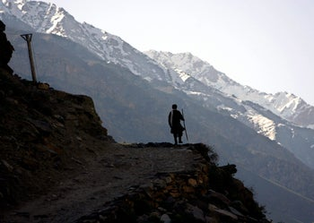 The infrastructure in Afghanistan does not lend itself to developing the nation's mineral wealth: A miner walking to the job at an emerald mine, Panjshir Valley, north of Kabul April 20, 2007.