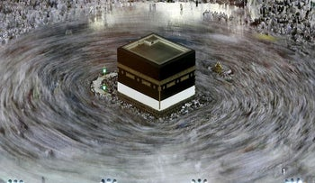 This long exposure photograph shows Muslim pilgrims circumambulating the Kaaba, Islam's holiest shrine, at the Grand Mosque in Saudi Arabia's holy city of Mecca on August 27, 2017, prior to the start of the annual Hajj pilgrimage