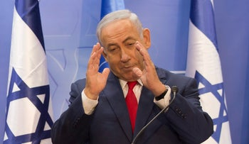 Prime Minister Benjamin Netanyahu gestures during a press conference with the UN secretary general at his office in Jerusalem on August 28, 2017.