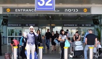 Travelers at Israel's Ben Gurion International Airport.