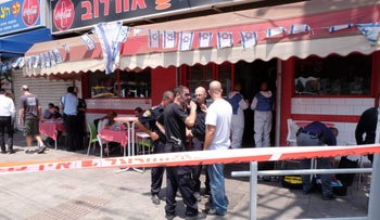 Security forces at the scene of a stabbing attack in Petah Tikva on July 24, 2017.