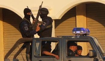 Egypt's riot police seen after security forces clashed with residents while attempting to demolish illegal buildings in the south of Cairo on July 17, 2017.