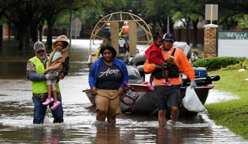Local residents are evacuated on an air boat after Hurricane Harvey caused heavy flooding in Houston, Texas, August 29, 2017.