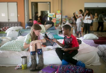 Volunteer Elizabeth Hill plays with evacuee Skyler Smith at a shelter at St. Thomas Presbyterian Church in west Houston after Hurricane Harvey on Tuesday August 29, 2017.