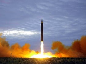 North Korea's intermediate-range strategic ballistic rocket Hwasong-12 lifting off from the launching pad on  August 29, 2017, in a photo released by Korean Central News Agency (KCNA).