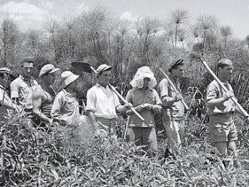 Members of Kibbutz Amir going to work in the Hula swamps, 1940.