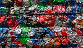 Sharp drop in number of Israeli households separating garbage for recycling. Illustration: Israel cans at a recycling factory