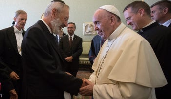 Pope Francis shakes hands with Riccardo Di Segni, Chief Rabbi of Rome, during an audience with the representatives of the Conference of European Rabbis, the Rabbinical Council of America and the Commission of the Chief Rabbinate of Israel at the Vatican, Thursday, Aug. 31, 2017.