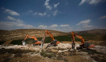 Diggers break the ground for a new Israeli settlement near the settlement of Shilo, West Bank, June 21, 2017.