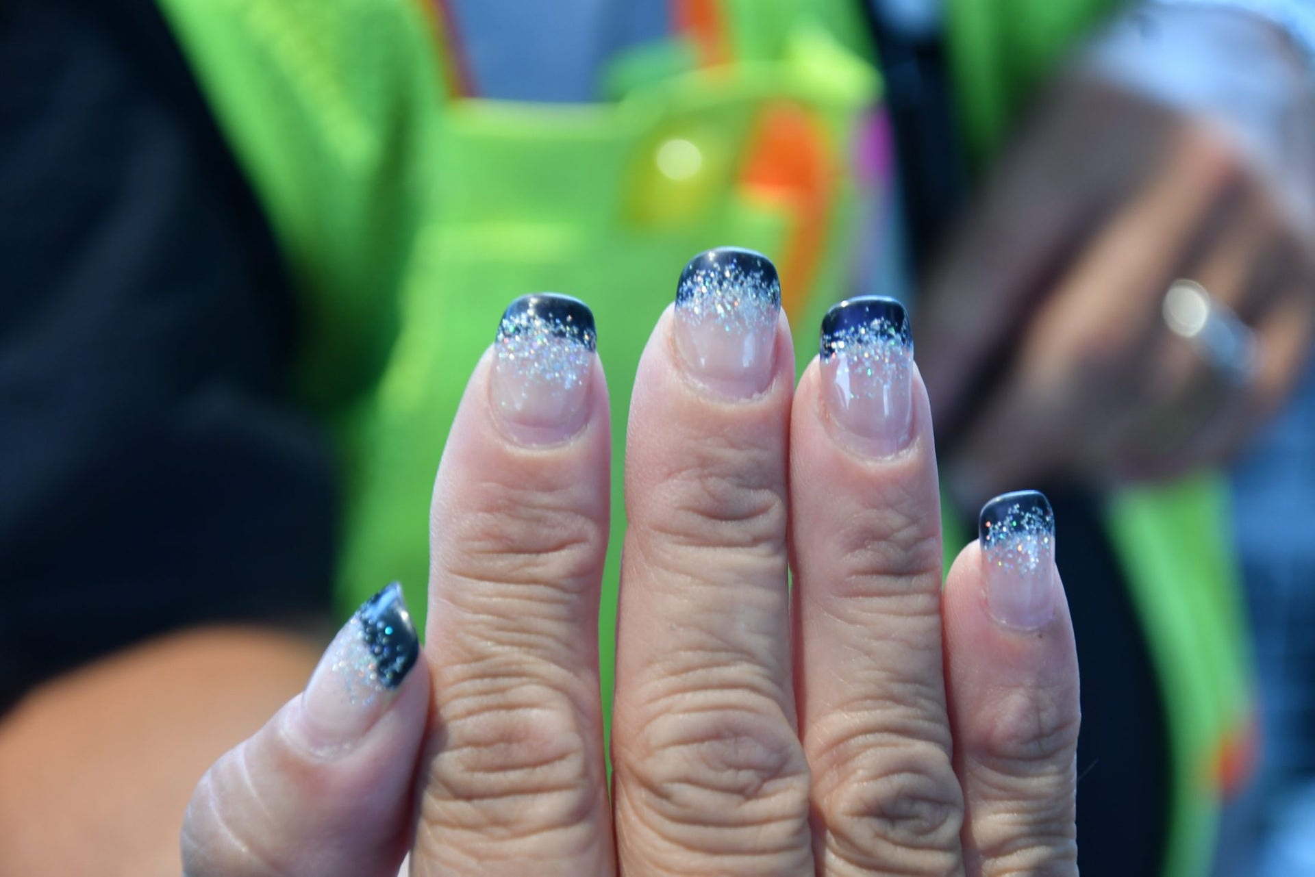 A woman in Anna, IL shows off her eclipse-themed manicure.