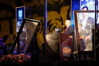 Prime Minister Benjamin Netanyahu speaks at the Barkan industrial zone in the West Bank at an event celebrating 50 years of settlements.