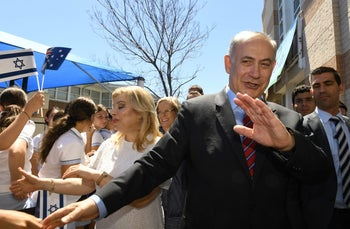 Israeli Prime Minister Benjamin Netanyahu and his wife Sara greet youths during their visit to the Moriah War Memorial College in Sydney, Australia, February 23, 2017.