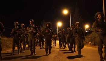 Israeli soldiers in a nighttime operation in Hebron (File)