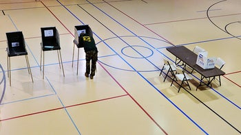 A man voting in Durham. Software that resulted in polling problems in the county was supplied by a company hacked by Russians months earlier.