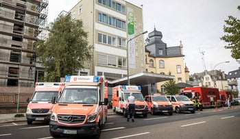 Numerous ambulances wait outside the Buerger hospital, which is to be evacuated due to a bomb disposal in Frankfurt, Germany, September 2, 2017.