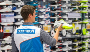 An employee at a Decathlon store in Berlin.
