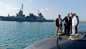 Prime Minister Benjamin Netanyahu, President Reuven Rivlin and Navy Commander Major general Ram Rothberg standing on top of the new submarine in March, 2017.