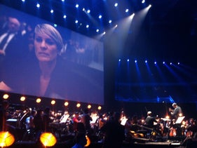'House of Cards in Concert' in Krakow, 2015, with Robin Wright's Claire Underwood projected behind the orchestra.