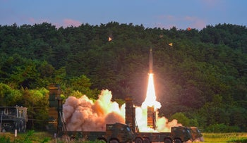 South Korea's missile system firing Hyunmu-2 missile into the East Sea from an undisclosed location during a live-fire exercise simulating an attack on North Korea's nuclear site on September 4, 2017.