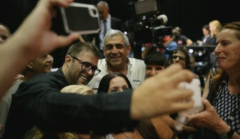 Knesset member Oren Hazan taking selfies at a rally in support of Netanyahu in the face of corruption probes on August 8, 2017.